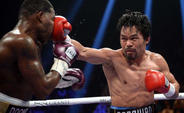 Manny Pacquiao (desno) je s prepričljivo januarsko zmago nad Adrienom Bronerjem dokazal, da še zdaleč ni za staro šaro. FOTO: USA Today Sports