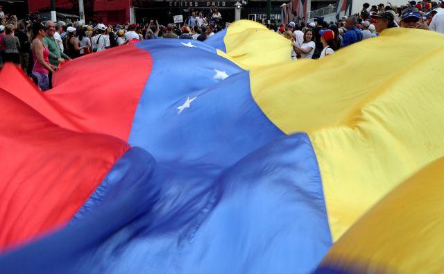 Sedemnajst oseb iz Venezuele je aprila zaprosilo Slovenijo za repatriacijo. Razmere v državi so vsak dan slabše, pišejo v prošnji. FOTO: Ivan Alvarado/Reuters