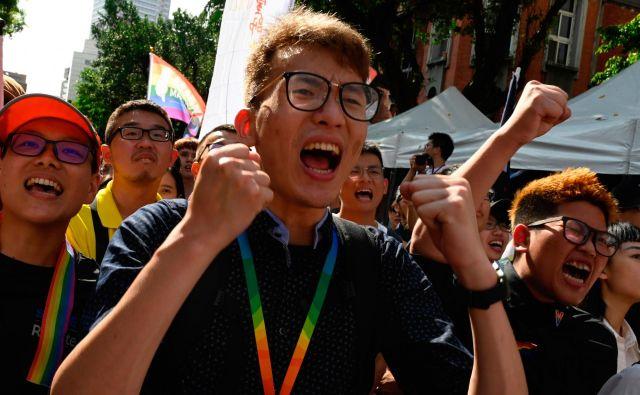 Zagovorniki zakona slavijo. FOTO: Sam Yeh/AFP