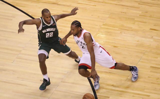 Kawhi Leonard je preigraval in priigral zmago Toronta. FOTO: Reuters