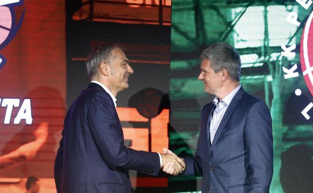 Poslovna partnerja in prijatelja Tomaž Berločnik (desno) ter Emil Tedeschi sta imela pogum, a za kaj več bo treba imeti še veliko sreče, znanja, spretnosti... FOTO: Blaž Samec/Delo