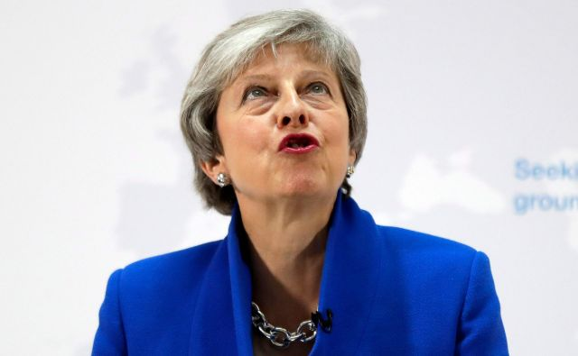 Theresa May FOTO: Kirsty Wigglesworth/AFP