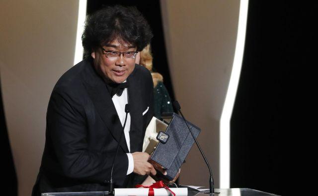 Zmagovalec Cannesa je s filmom Parazit postal Džun Ho Bong. FOTO: Eric Gaillard/Reuters