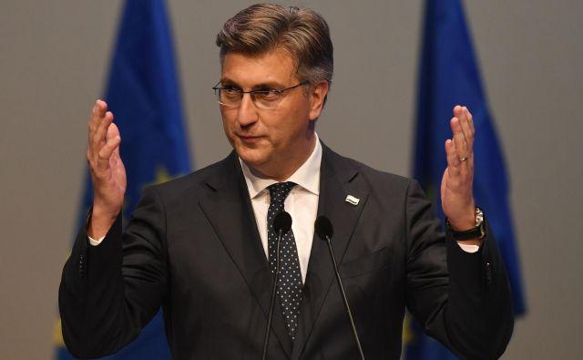 Plenković je slab rezultat pripisal razpršitvi glasov, ker je šla HDZ samostojno na volitve. FOTO: Christof Stache/AFP