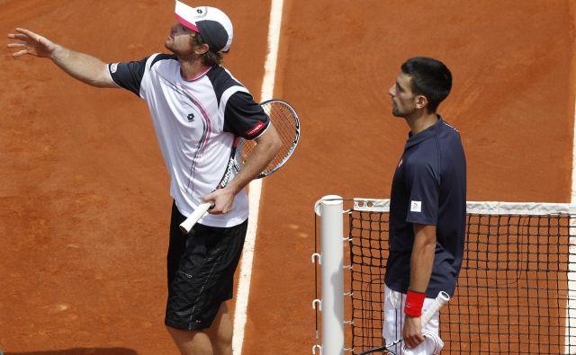 Na OP Francije se je Blaž Kavčič meril tudi s prvim igralcem sveta Novakom Đokovićem. FOTO: Reuters