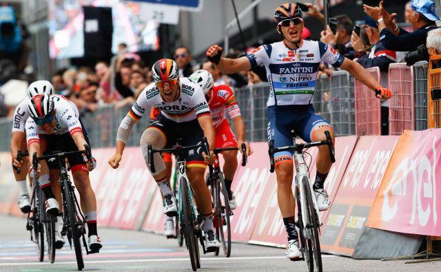 Damiano Cima je zmagal za nekaj decimetrov.FOTO: AFP