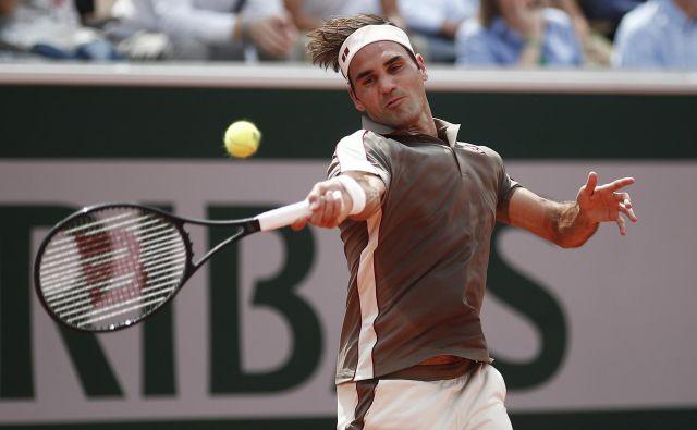 Roger Federer je dobil švicarsko klasiko s Stanom Wawrinko. FOTO: Reuters