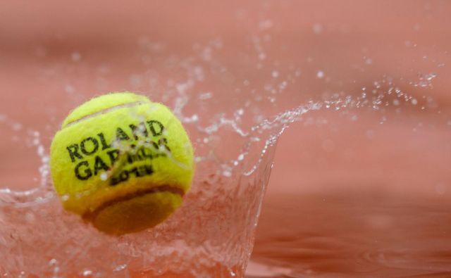 Dež in slabe vremenske napovedi ponagajali prirediteljem turnirja za grand slam. FOTO: AFP