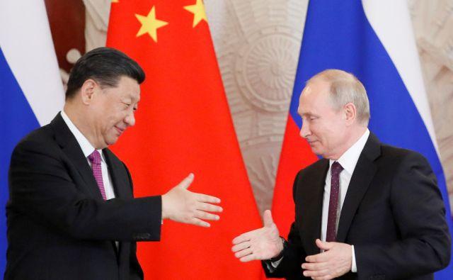 »Rusko-kitajski odnosi so dosegli do zdaj neznano raven,« je Putin povedal na srečanju s Xijem. FOTO: Evgenia Novozhenina Reuters
