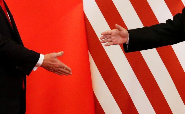 Donald Trump in Xi Jinping si bosta v roke segla znova konec meseca. Po tem srečanju bo več znanega o nadaljevanju trgovinske vojne. Foto Reuters.