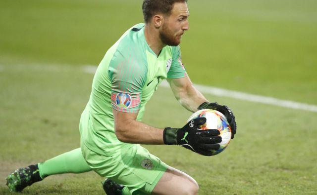Slovenske nogometaše je v prvem polčasu nekajkrat rešil vratar Jan Oblak. FOTO: Roman Š�ipić/Delo