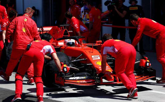 Prvouvrščeni Sebastian Vettel. FOTO: Dan Istitene Afp