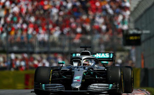 Lewis Hamilton se je veselil 78. zmage v karieri. FOTO: AFP