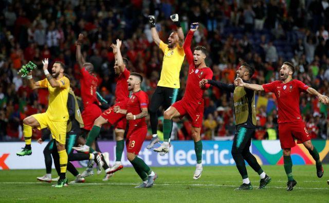 Na evropskem prvenstvu prihodnje leto bodo Portugalci igrali kot zmagovalci dveh največjih celinskih tekmovanj, kot evropski prvaki in zmagovalci lige narodov. FOTO: Reuters