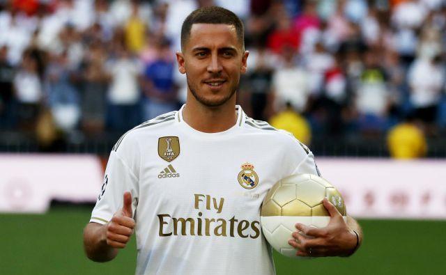 Eden Hazard ob prihodu v Madrid ni skrival dobre volje. FOTO Reuters