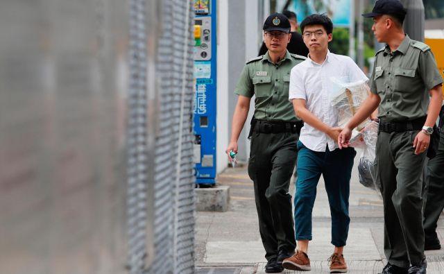 Nekdanji voditelj študentov Wong je po izpustitvi že napovedal, da se bo pridružil protestom. FOTO: Tyrone Siu/Reuters