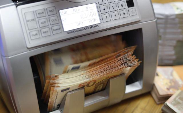 Euro denar. Ljubljana, 19. januar 2018 [euro,korupcija,Ljubljana,denar,motivi] Foto Leon Vidic/delo