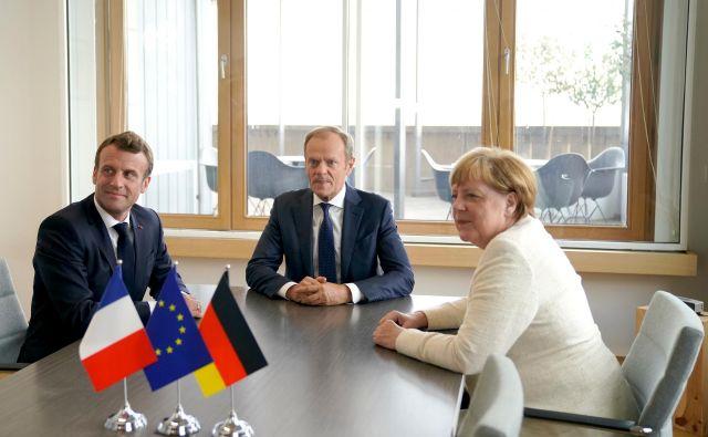 Brez soglasja Francije in Nemčije ne bo napredka v izbiranju vodilnih predstavnikov EU. Kanclerka Angela Merkel in predsednik Emmanuel Macron sta se usklajevala z Donaldom Tuskom že pred samim vrhom. FOTO:Kenzo Tribouillard/REUTERS