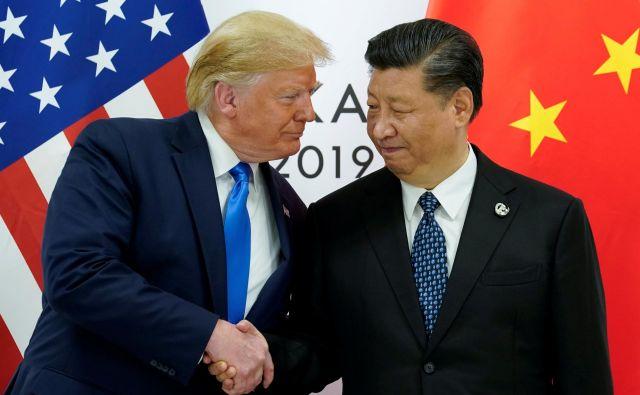 Donald Trump in Xi Jinping. FOTO: Reuters