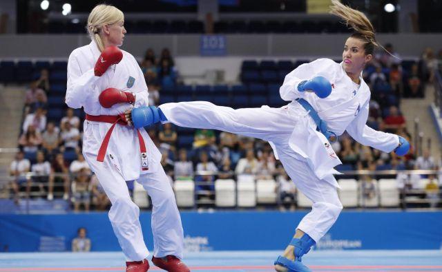 Na evropskih igrah v Minsku je slovenska karateistka Tjaša Ristić v finalu borb do 61 kilogramov izgubila proti Ukrajinki Aniti Serogin in osvojila srebrno kolajno. Pred tem je Gorenjka v polfinalu s 4:2 ugnala Francozinjo Gwendoline Philippe, v predtekmovalni skupini pa je zabeležila poraz, neodločen izid in zmago, v skupini je zasedla drugo mesto. FOTO: Vasily Fedosenko/REUTERS