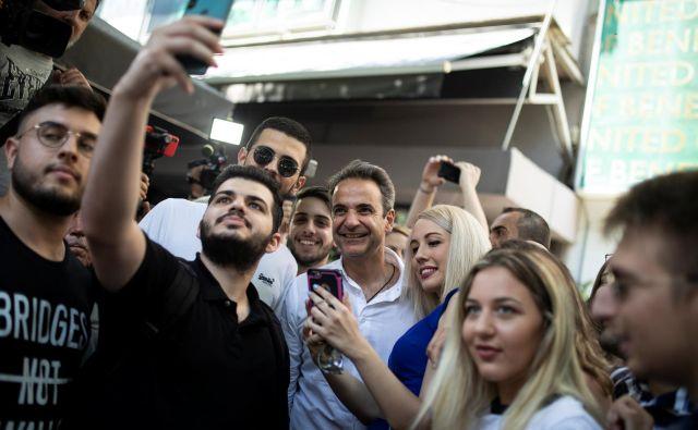 Kiriakos Micotakis je naslednik dinastije, ki je dolgo obvladovala desni pol grške politike, v predvolilni kampanji pa je poskušal delovati kot »evropski politik z modernimi populističnimi nastavki«. Foto Reuters