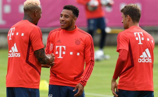 Jerome Boateng, Corentin Tolisso in Thomas Müller so bili za začetek priprav dobre volje. FOTO AFP