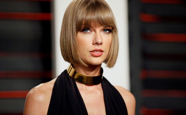 Taylor Swift je od lanskega junija zaslužila 185 milijonov ameriških dolarjev (okoli 164 milijonov evrov), kar je največ doslej. FOTO: Danny Moloshok/Reuters