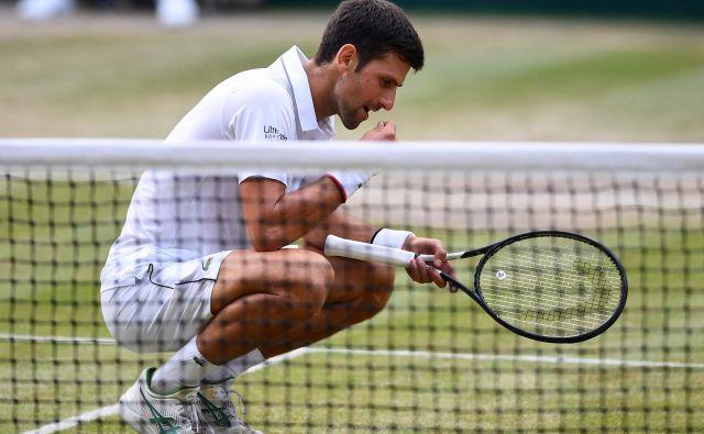 Za Novaka Đokovića ima ob vsaki wimbledonski zmagi trava boljši okus. FOTO: AFP