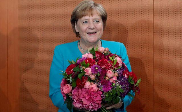 Mediji so se zadnje tedne spraševali predvsem o njenem zdravju, saj jo je na več dogodkih pred javnostjo zajela tresavica. FOTO: Fabrizio Bensch/Reuters