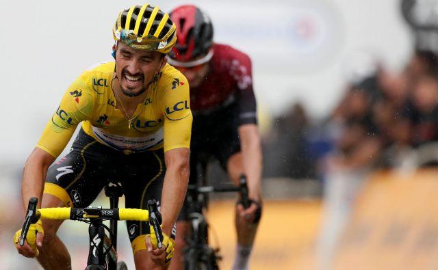 Julian Alaphilippe je bil na Albisu v težavah, a je omilil svoje izgube. FOTO: Reuters