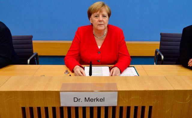 Angela Merkel med tradicionalno poletno novinarsko konferenco. FOTO: John MacDougall/AFP