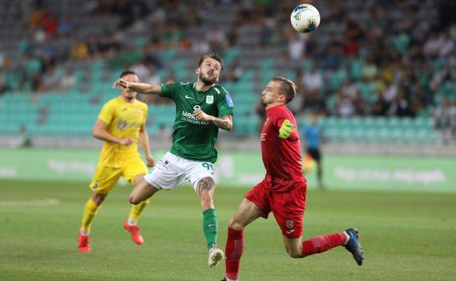 Asmir Suljić je začel v upočasnjenem ritmu, po zaostanku pa stinil na plin in bil najzaslužnejši za Olimpijin zasuk proti Domžalam. FOTO: Voranc Vogel/Delo