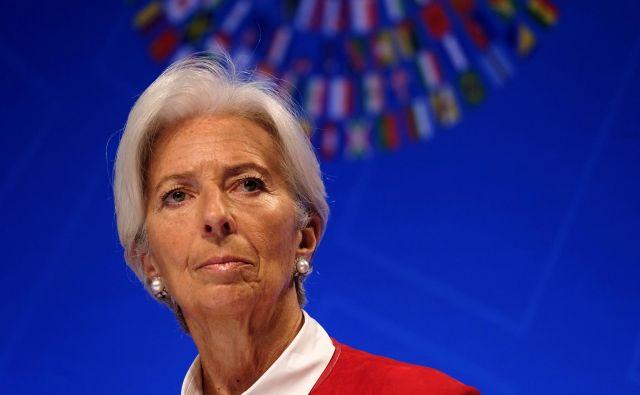 IMF – na fotografiji njegova donedavna izvršna direktorica Christine Lagarde, ki naj bi prevzela krmilo ECB – opozarja, da trgovinske vojne in geopolitične napetosti znižujejo gospodarske obete. FOTO: Reuters