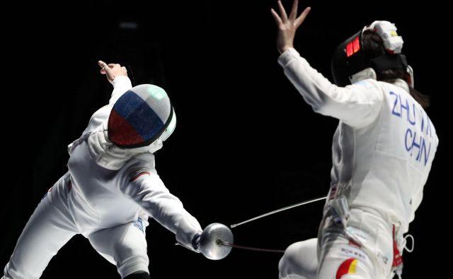 Rusinja Violetta Khrapina proti Kitajki Mingye Zhu. FOTO: Peter Kohalmi/AFP