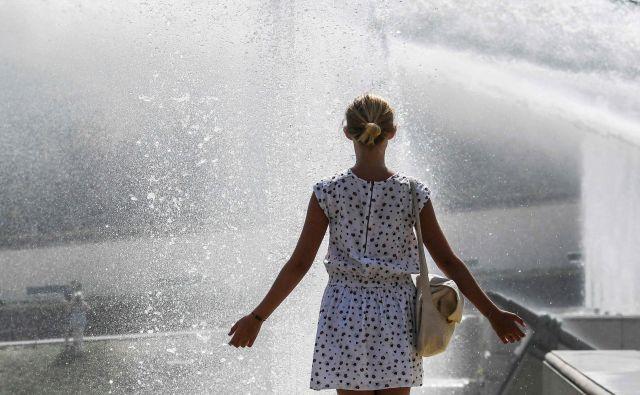 Parižani pričakujejo rekordno visoke temperature. FOTO: Alain Jocard/AFP