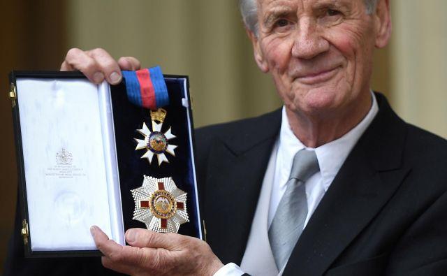 Michael Palin v Buckinghamski palači po imenovanju za viteza komandanta reda sv. Mihaela in sv. Jurija. FOTO: Reuters
