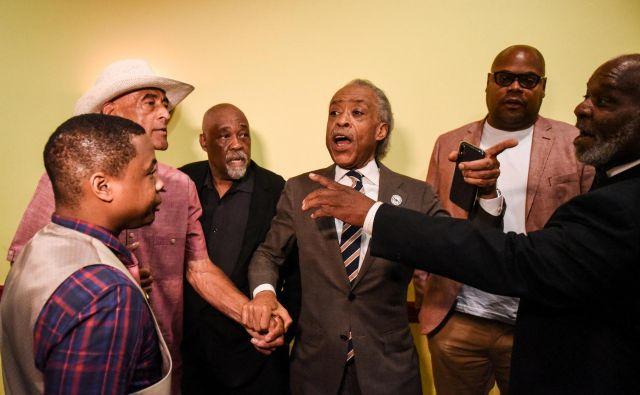 Razburjenje v Baltimoru. Častiti Al Sharpton je samo zaradi obsodbe predsednika odpotoval tja. Foto Reuters