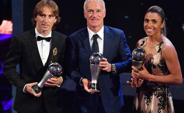 Lanski dobitniki nagrad: Luka Modrić, Didier Deschamps in Marta. FOTO: AFP