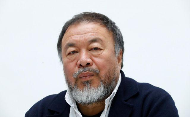 Kitajski umetnik Ai Weiwei na konferenci ob razstavi »Vse je umetnost. Vse je politika« v Düsseldorfu maja letos. FOTO: Ralph Orlowski/Reuters