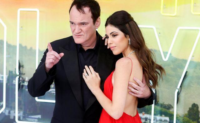 Sloviti režiser Quentin Tarantino z dve desetletji mlajšo ženo Daniello Pick. FOTO: Reuters