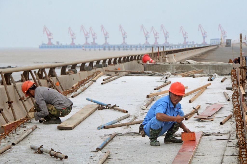 FOTO:Svetovno gospodarstvo se ohlaja – a kako močno?