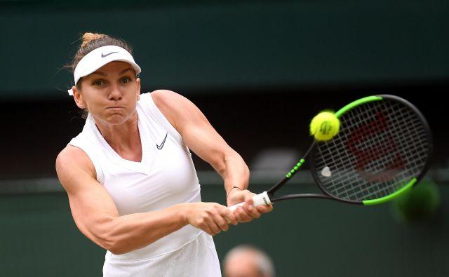 Simona Halep se je v Wimbledonu razveslila največje lovorike in bo lahko zdaj bolj sproščeno igrala na velikih slamih. Foto AFP