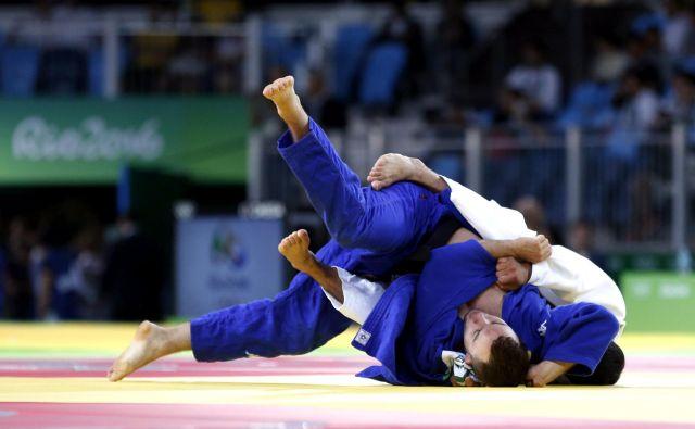 Adrian Gomboc (v modrem kimonu) se je od svetovnega prvenstva v Tokiu poslovil v šestnajstini finala. FOTO: Matej Družnik