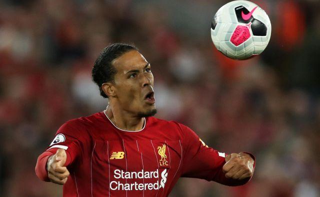 Virgil van Dijk je osvojil ligo prvakov z Liverpoolom in postal najboljši igralec minule sezone. FOTO: Reuters