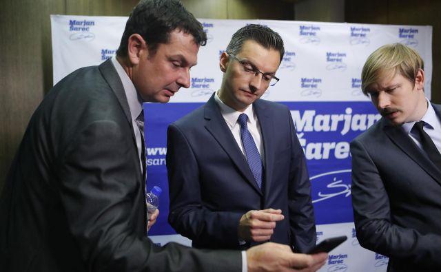 Marjan Šarec, prvak LMŠ (v sredini), se je moral odpovedati enemu od svojih zaupnikov in tesnih sodelavcev ter generalnemu sekretarju stranke Branetu Kralju (levo). FOTO: Leon Vidic