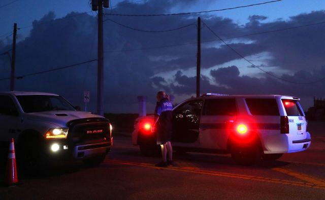 Policisti so že uspeli najti 9-milimetrsko pištolo, s katero je 14-letnik zakrivil umore.Fotografija je simbolična. FOTO: Mark Wilson/AFP
