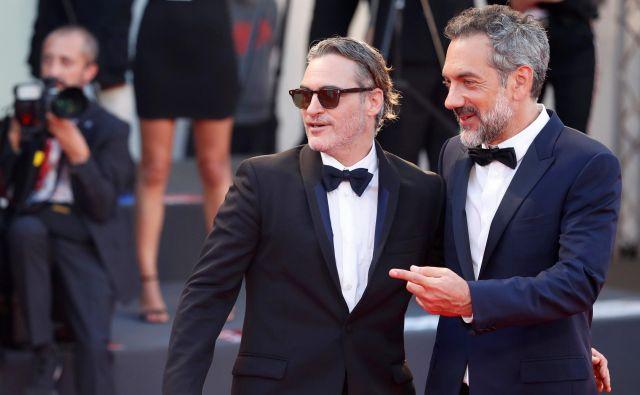 Igralec Joaquin Phoenix in režiser Todd Phillips FOTO: Reuters