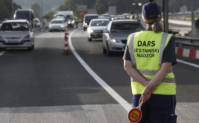 a zagotavljanje pretočnosti prometa bodo na terenu policisti in kranjski mestni redarji. FOTO: Mavric Pivk/Delo
