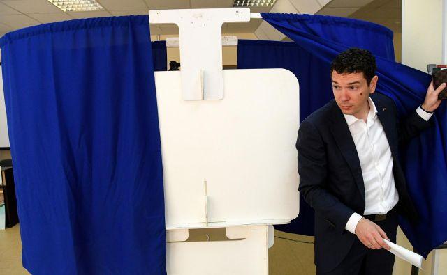 Prihodnjih pet let bo v 45-članskem mestnem parlamentu sedelo 25 poslancev vladajoče stranke, ki so na volitvah nastopili kot samostojni kandidati. Foto: AFP