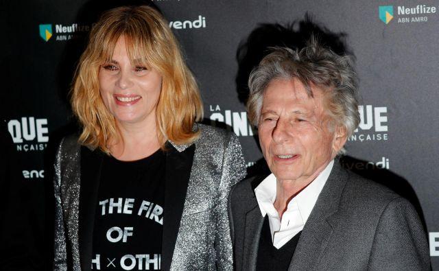 Francoska igralka Emmanuelle Seigner in režiser Roman Polanski v Parizu na premieri njegovega filma Po resnični zgodbi pred dvema letoma.<br /> FOTO: Charles Platiau Reuters